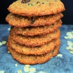 A close up image of a stack of oatmeal raisin cookies