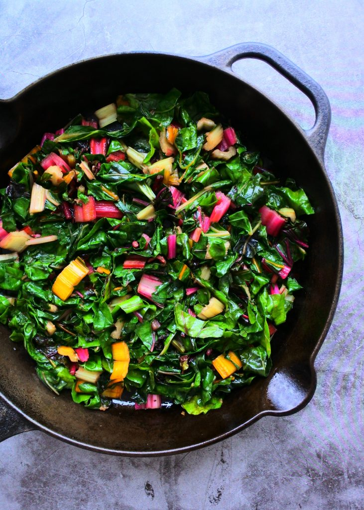 An overhead image of sauteed rainbow chard in a skillet
