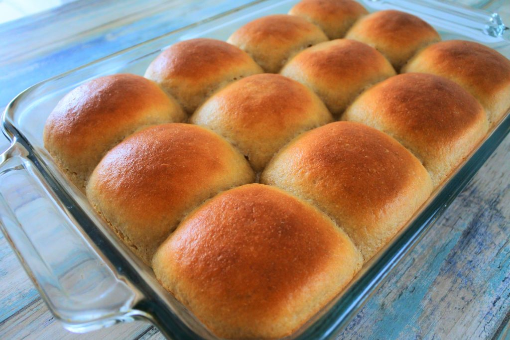 An angled image of freshly baked dinner rolls in a baking dish
