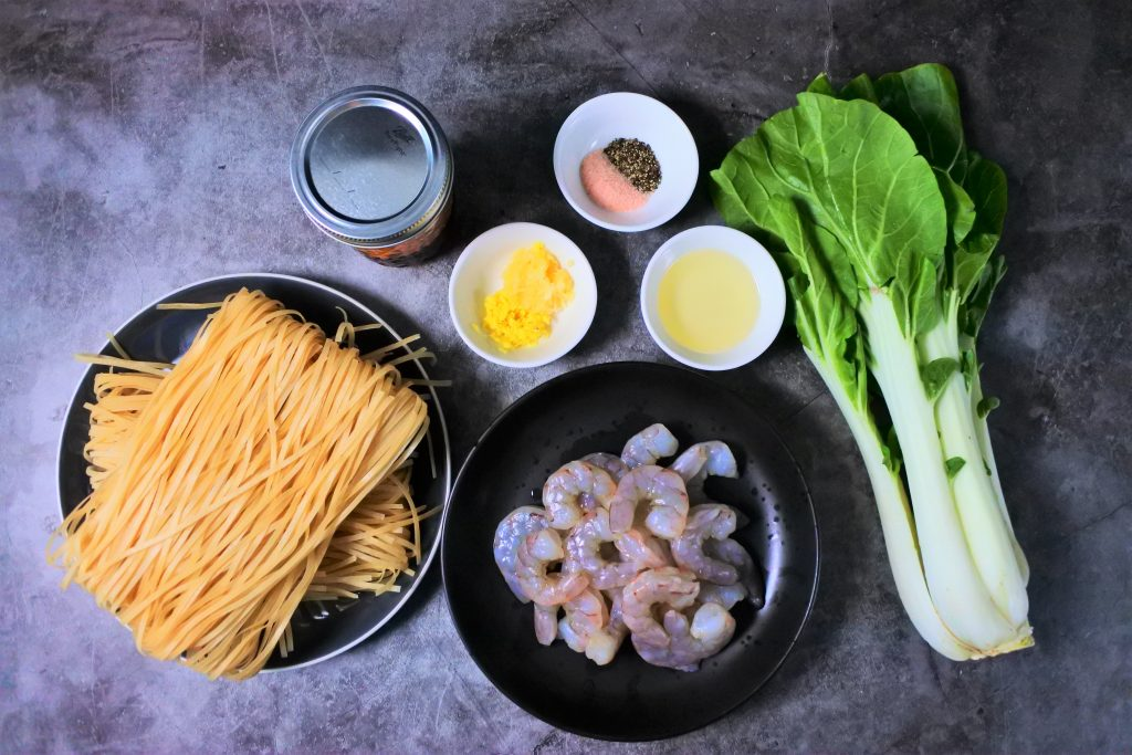 An overhead image of ingredients for an easy shrimp stir fry that uses leftover drippings