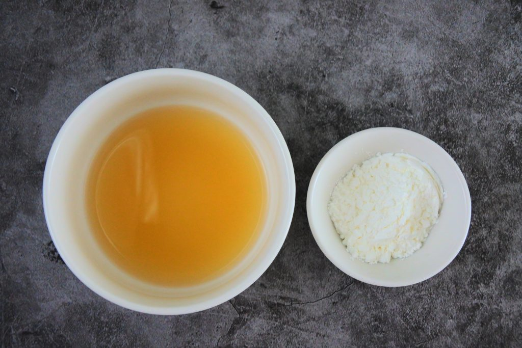 An overhead image of stock and starch in two bowls
