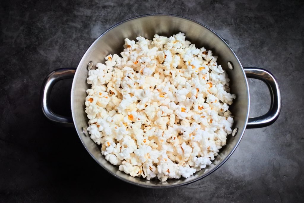 An overhead image of popped popcorn in a pot