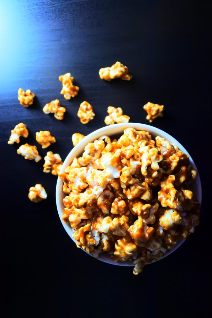 An overhead image of a bowl of caramel popcorn