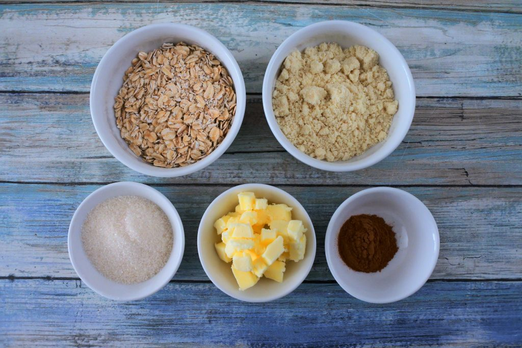 An overhead image of bowls of ingredients for streusel topping