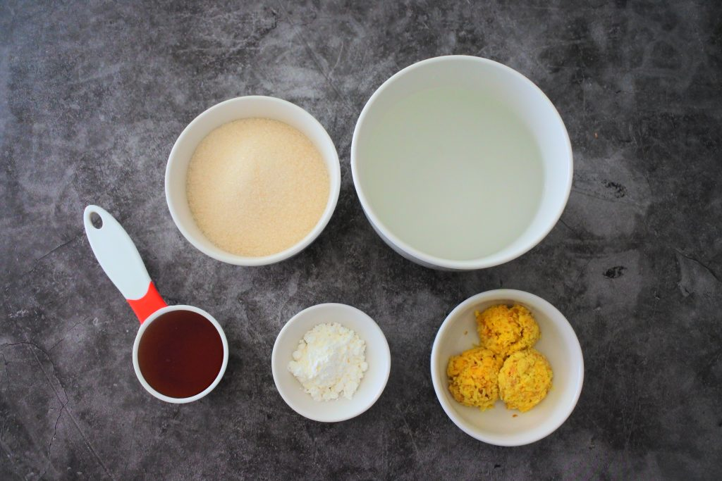 An overhead image of ingredients for honey ginger candy chews