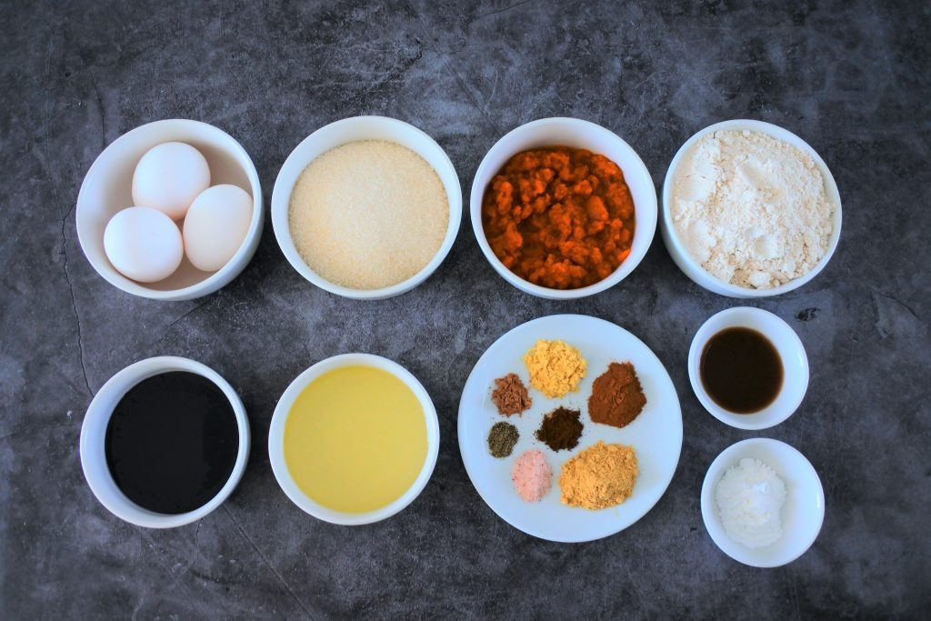 An overhead image of dishes of ingredients for a homemade gingerbread loaf