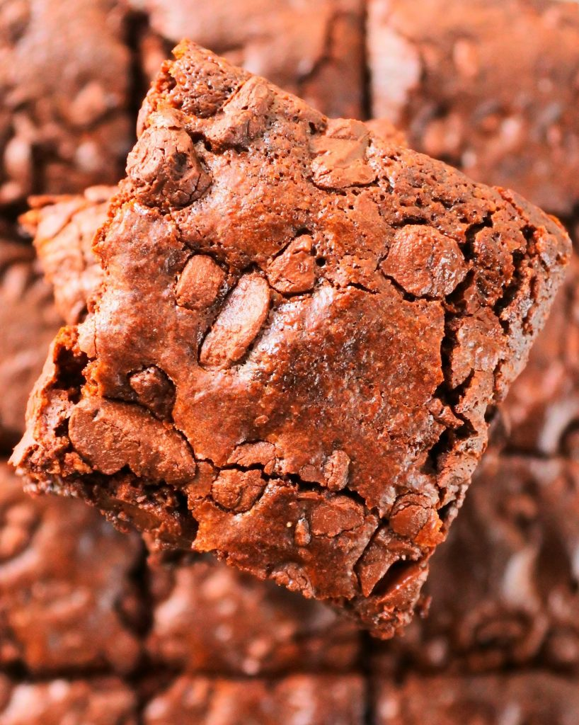 An overhead image of the top of a stack of chewy gluten free brownies.