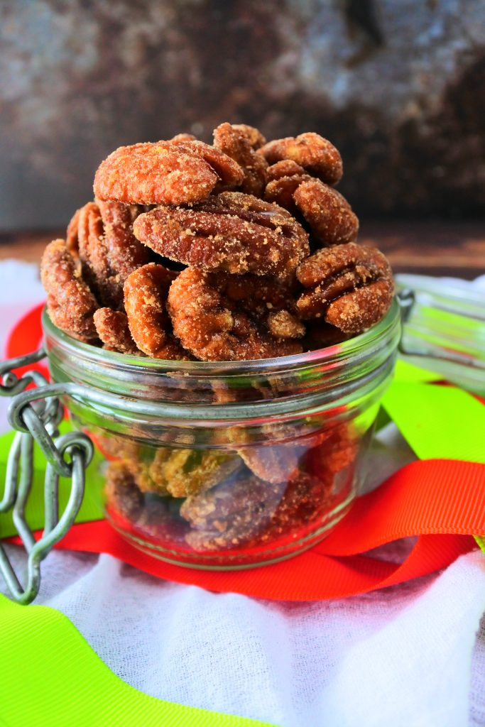 A head on image of maple candied pecans in a glass jar