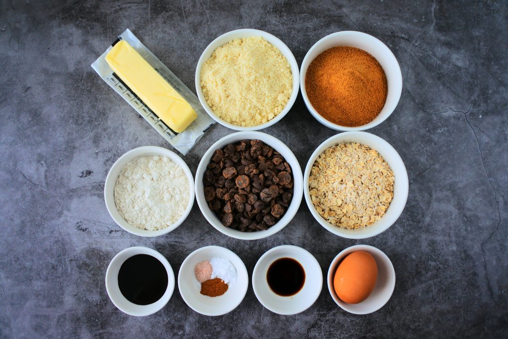 An overhead image of bowls of ingredients for oatmeal chocolate chip cookies