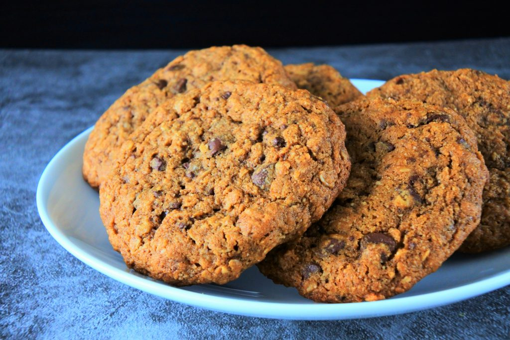 A plate of freshly baked oatmeal chocolate chip cookies
