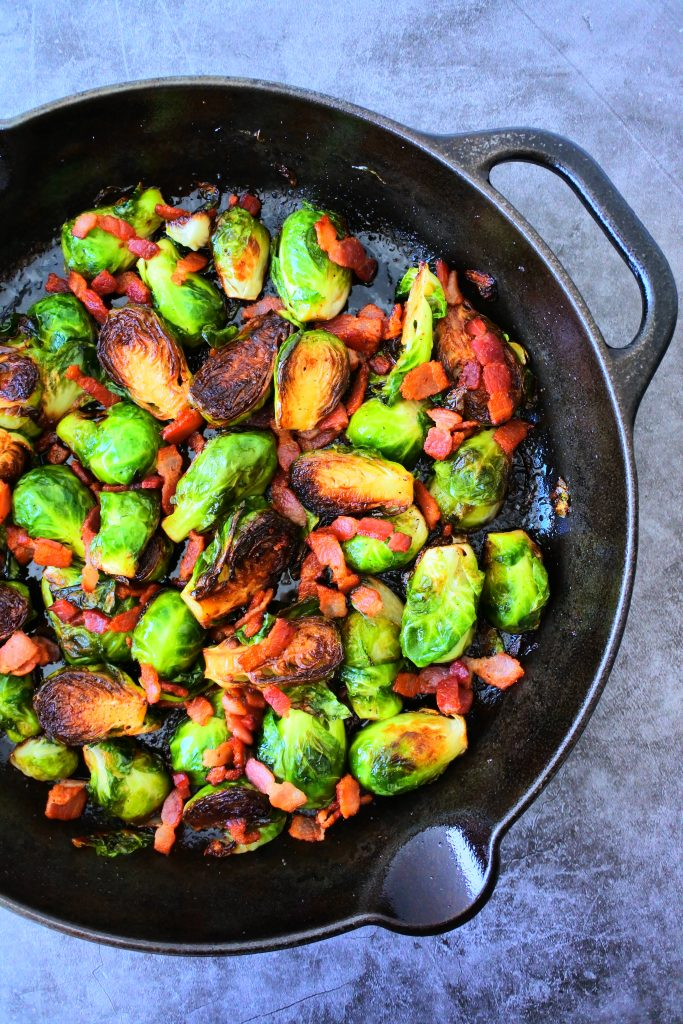 An overhead image of a skillet of maple bacon brussels sprouts