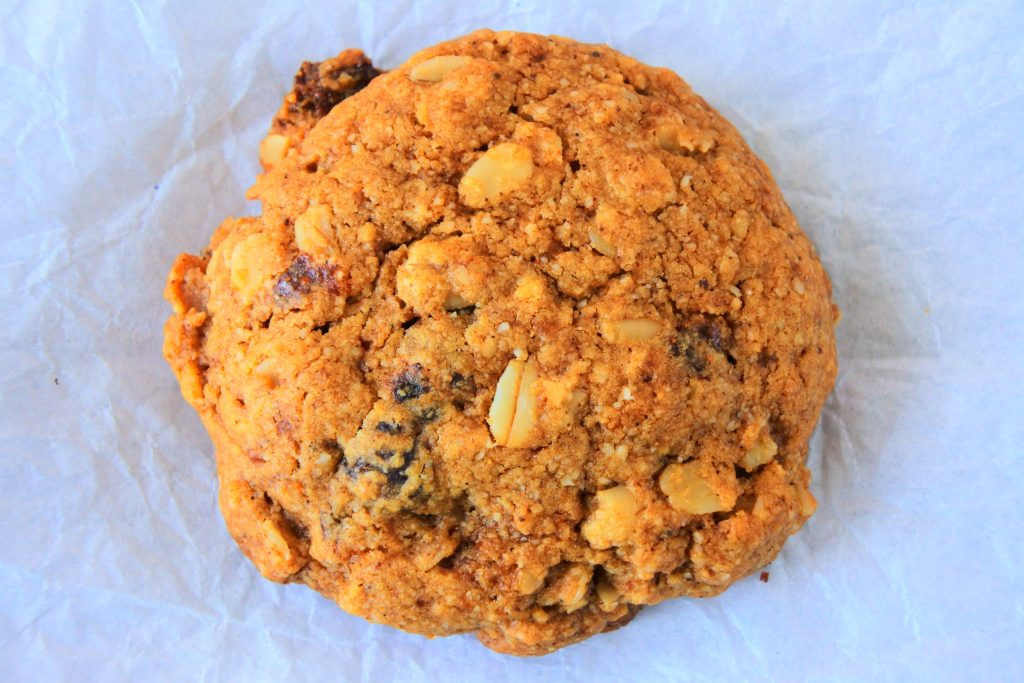 A close up overhead image of an oatmeal raisin cookie