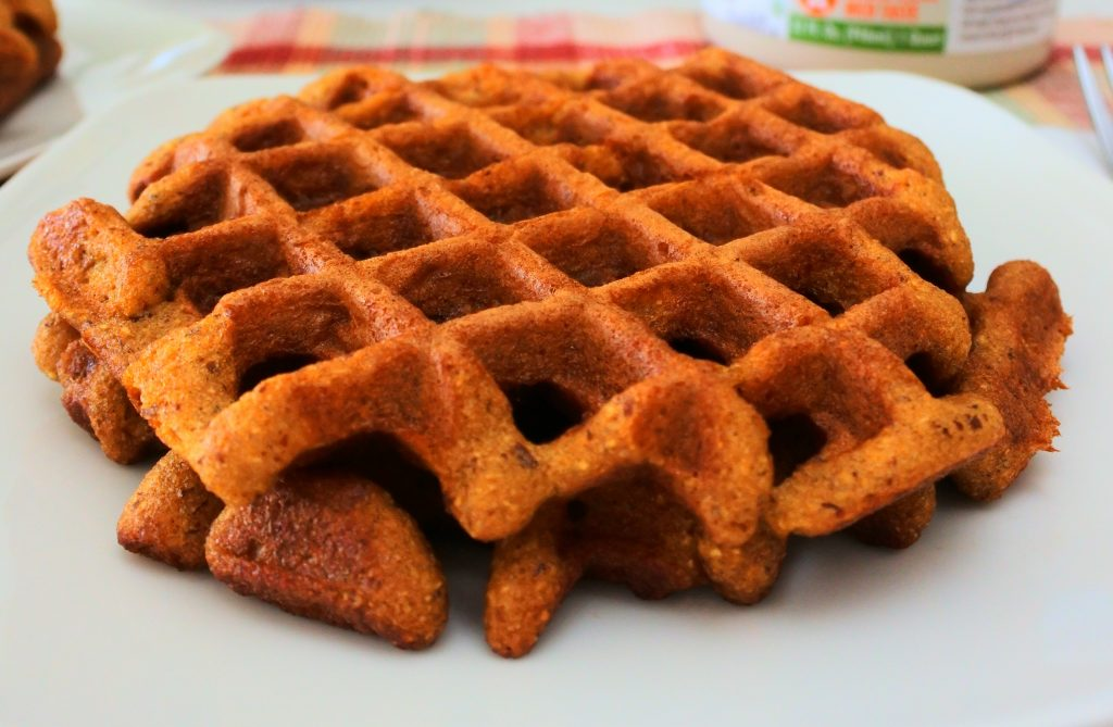 A close up image of clean eat almond flour waffles