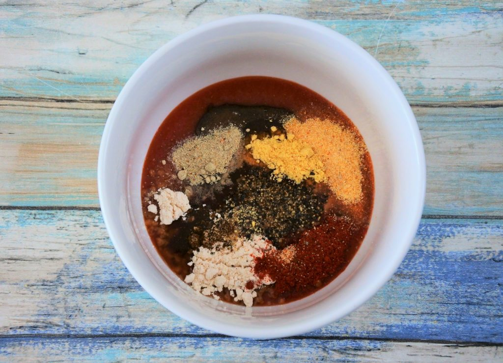 An overhead image of a bowl of ingredients for a homemade bbq sauce before being mixed