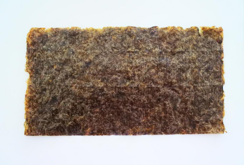 Overhead image of a half-sheet of sushi nori (seaweed)