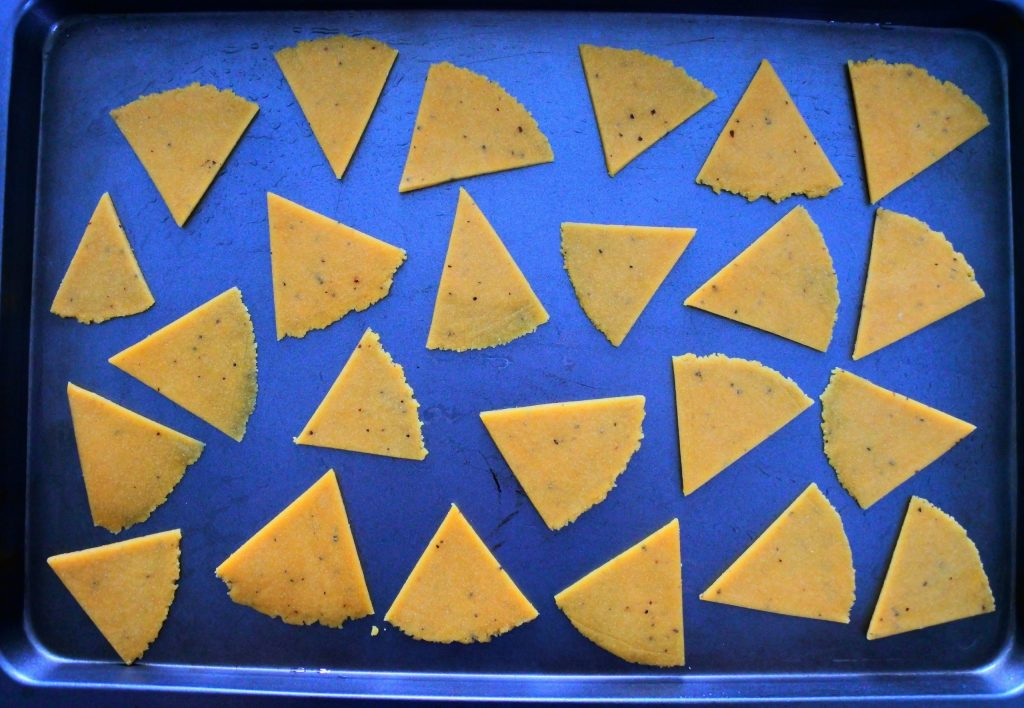 An overhead image of a tray of unbaked chickpea crackers