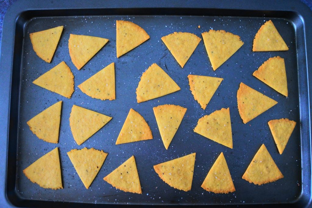 An overhead image of a tray of baked chickpea crackers