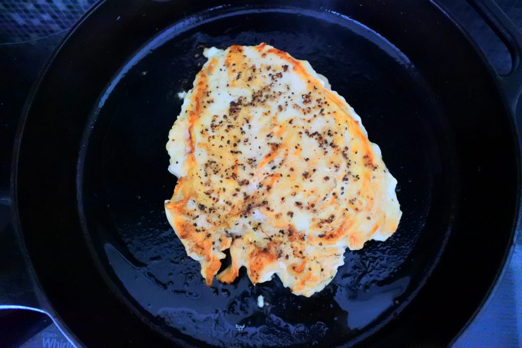 An overhead image of sliced pan seared chicken breast in a skillet