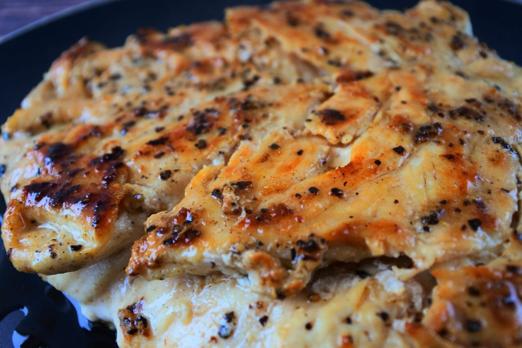 A close up image of sliced pan seared chicken breast