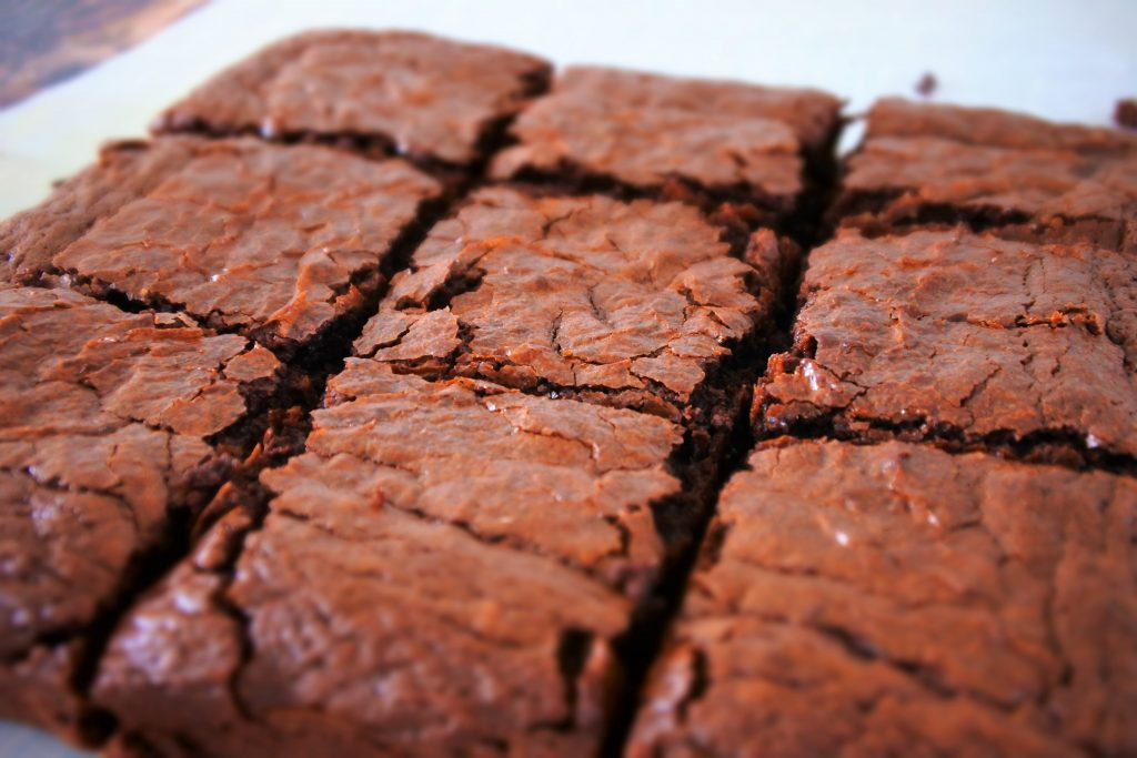 An angled image showing the top of a tray of cut brownies