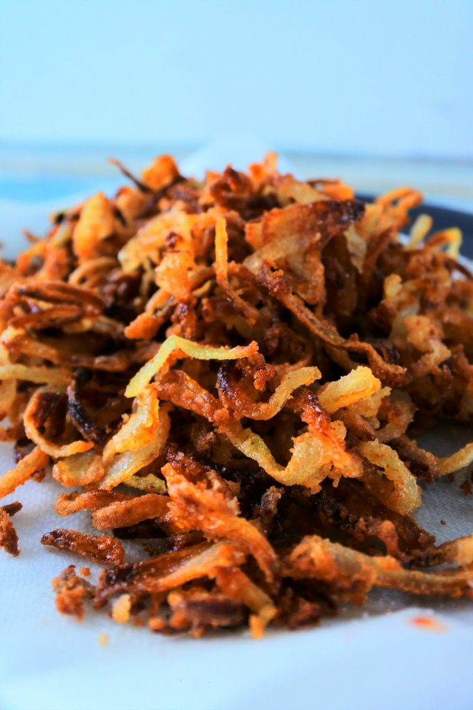 A head on close up image of crispy fried onions