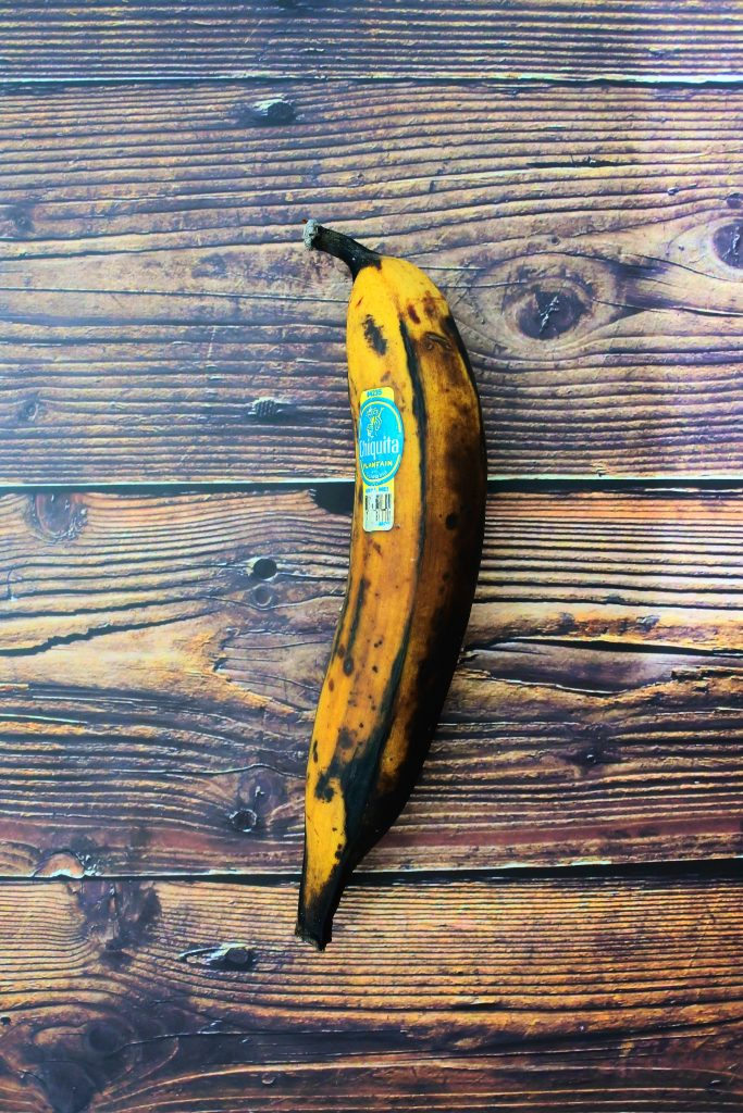 An overhead image of a whole ripe plantain