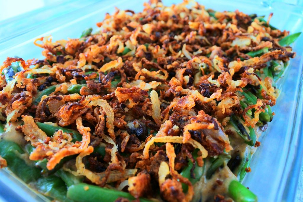 An angled image of crispy onions on a green bean casserole