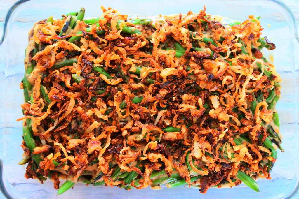 An overhead image of crispy onions on a green bean casserole