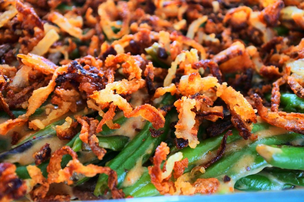 A close up image of crispy onions on a green bean casserole