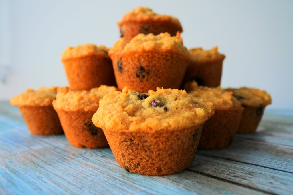 A close up image of a pyramid of chocolate chip mini muffins