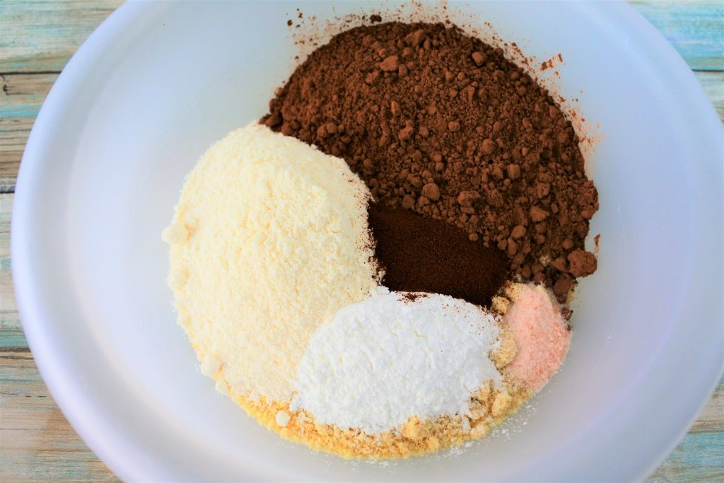 An overhead image of dry ingredients for GF Double Chocolate Muffins in a bowl