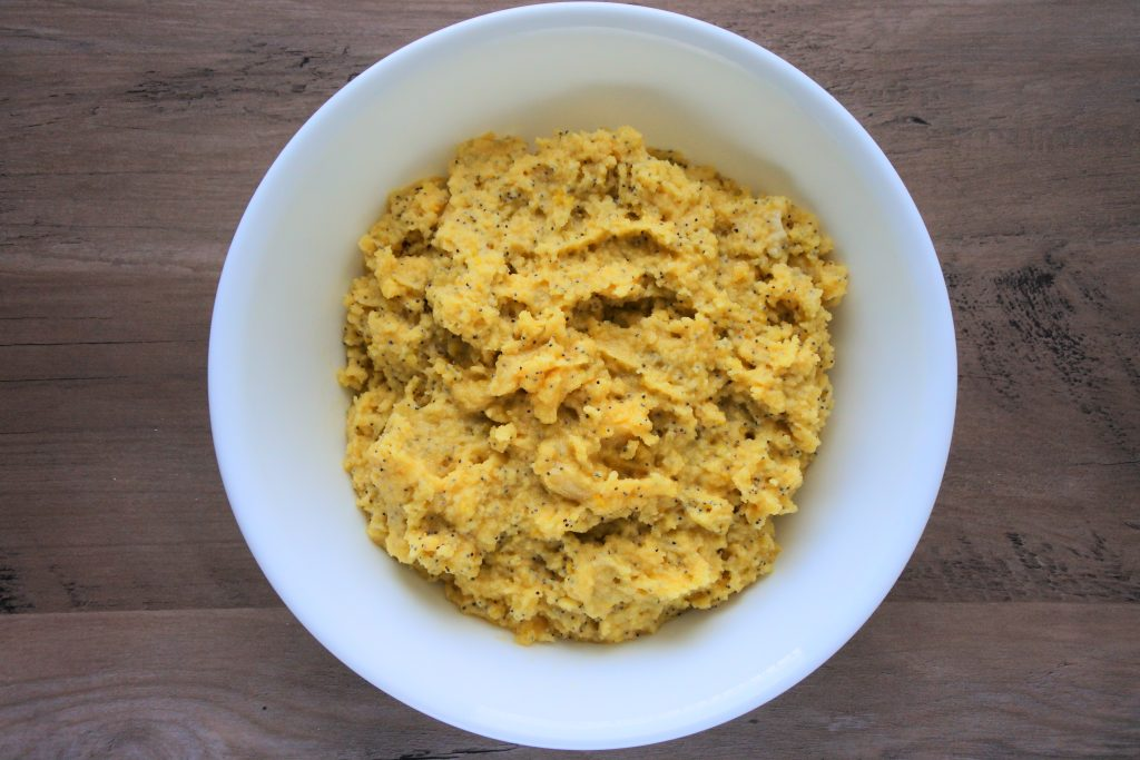 An overhead image of a bowl of lemon poppyseed muffin batter