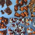 A head on image of pieces of peanut butter bark with various toppings