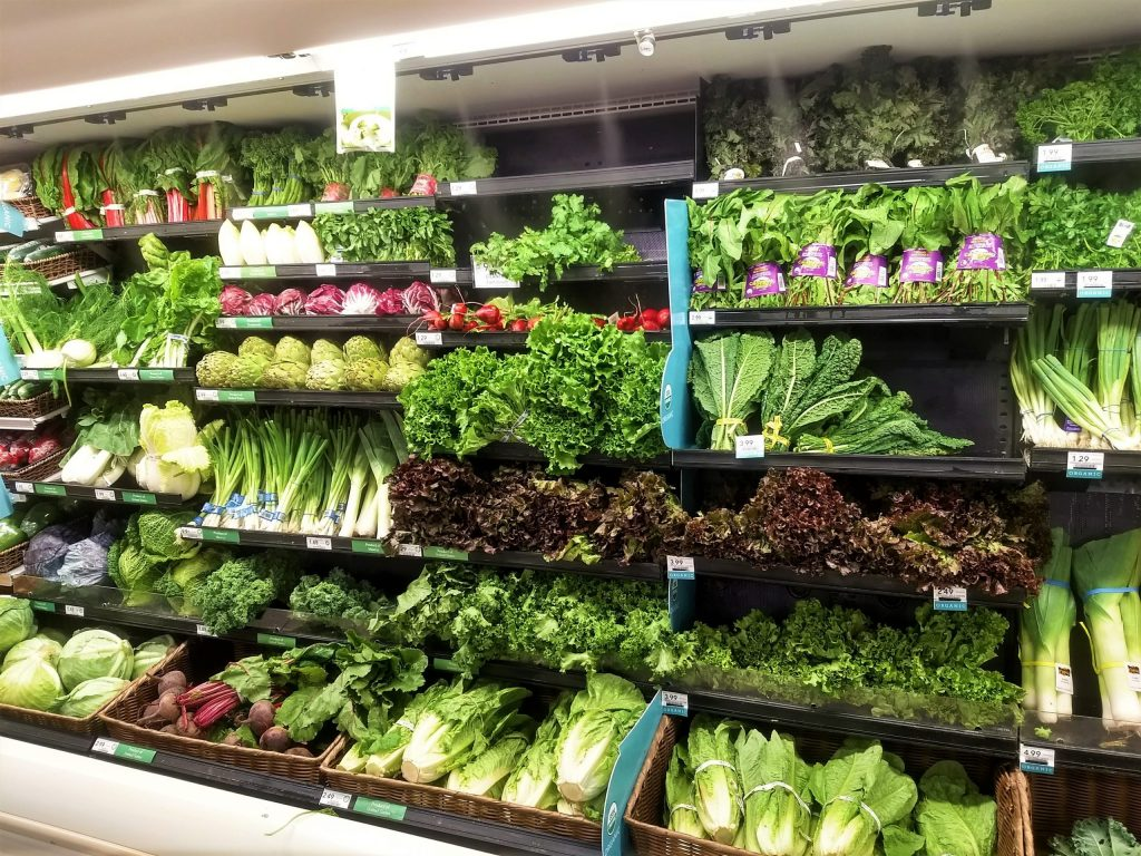 Image of a supermarket's fresh green produce aisle