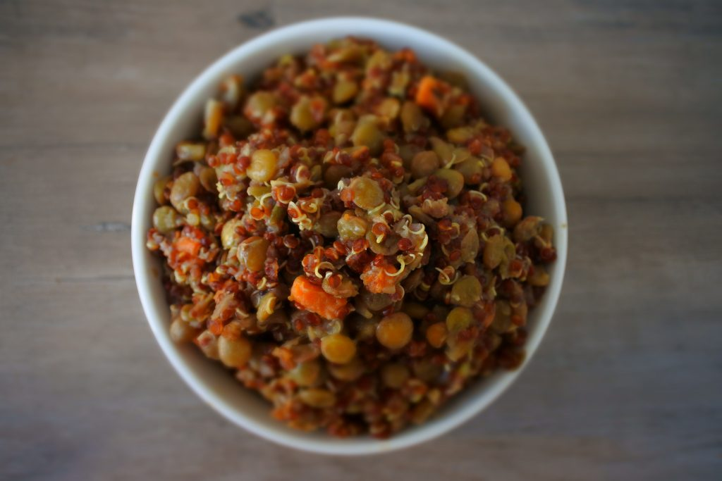 An overhead image of a bowl of quinoa and lentil pilaf