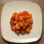 An overhead image of a plate of chipotle fried shrimp