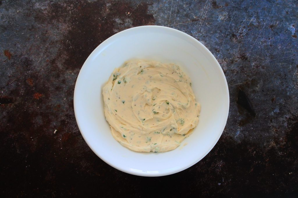 An overhead image of a bowl of creamy dip mixture
