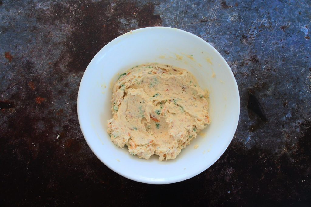 An overhead image of a bowl of mixed in smoked trout dip